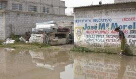 """""""La inundación dañó viviendas, calles, áreas de uso común; escuelas de la comunidad, creando focos de infección, sin embargo el edil Pablo Bedolla López no han enviado apoyo"""", afirman vecinos. Foto: Archivo"""